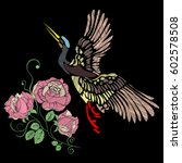 embroidery of a crane and roses ... | Shutterstock .eps vector #602578508
