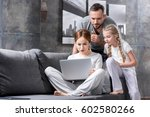 pensive young family using... | Shutterstock . vector #602580266