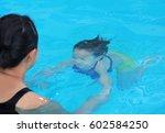 little girl diving training... | Shutterstock . vector #602584250