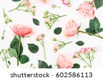 Stock photo floral pattern with pink flowers branches and leaves on white background flat lay top view 602586113