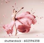 ballerina dancing in flowing... | Shutterstock . vector #602596358