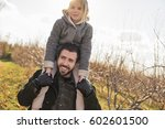 a man giving a child a ride on... | Shutterstock . vector #602601500