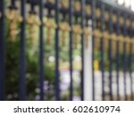 Blurred Alloy Fence With Tree...