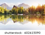 the sunrise over a lake in the... | Shutterstock . vector #602615090