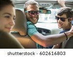 a group of people inside a car  ... | Shutterstock . vector #602616803
