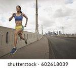 a woman running along an urban... | Shutterstock . vector #602618039