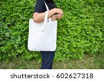 girl is holding blank tote bag... | Shutterstock . vector #602627318