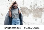 hipster girl wearing blank gray ... | Shutterstock . vector #602670008