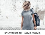 hipster girl wearing blank gray ... | Shutterstock . vector #602670026