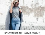 hipster girl wearing blank gray ... | Shutterstock . vector #602670074