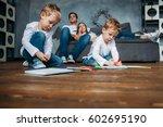 children draw markers on floor... | Shutterstock . vector #602695190