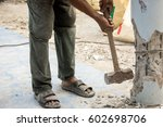worker holding hammer and smash ... | Shutterstock . vector #602698706