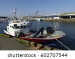 Fishing Boat Docked  Alongside...