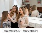 a professional make up artist... | Shutterstock . vector #602728184