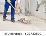manual worker sweeping rough...   Shutterstock . vector #602733830