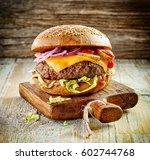 fresh tasty burger on wooden... | Shutterstock . vector #602744768