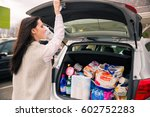 grocery shopping done   woman ... | Shutterstock . vector #602752283