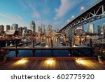 Stock photo vancouver false creek at night with bridge and boat 602775920
