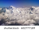 Small photo of Himalaya mountains summits, Everest and Lhotse on the left, Mt. Makalu on the right, with snow flags and clouds, view from plane
