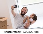 young father and his son... | Shutterstock . vector #602823788