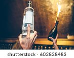 waiter is holding bottles of... | Shutterstock . vector #602828483