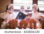 group of famale friends in spa... | Shutterstock . vector #602836130
