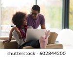 happy young african american... | Shutterstock . vector #602844200