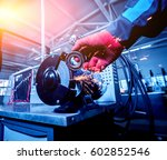 cleaning of car parts on the... | Shutterstock . vector #602852546