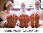 group of famale friends in spa... | Shutterstock . vector #602855234