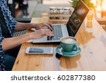 asian woman working at a coffee ... | Shutterstock . vector #602877380