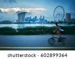 fast moving cyclists at park... | Shutterstock . vector #602899364