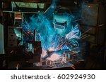 worker is welding assembly... | Shutterstock . vector #602924930