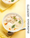 Yogurt chicken and rice soup with large chunks of chicken and chick peas - stock photo