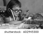 Stock photo the girl with the cat playing doctor 602945300