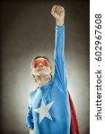 senior superhero man in blue... | Shutterstock . vector #602967608