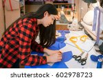 young woman seamstress making... | Shutterstock . vector #602978723