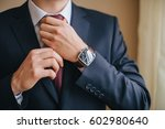 a man in a suit with a clock on ... | Shutterstock . vector #602980640