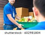 delivery man taking food basket ... | Shutterstock . vector #602981804