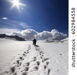 two hikers on snow plateau at...