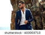 man in elegant suite posing in...   Shutterstock . vector #603003713
