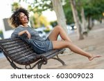 young black woman with afro... | Shutterstock . vector #603009023