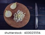 sliced onions with knife on... | Shutterstock . vector #603025556