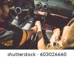 couple driving on a convertible ... | Shutterstock . vector #603026660