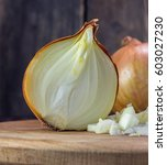 chopped onions on wooden... | Shutterstock . vector #603027230