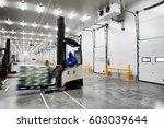 worker stand on stacker truck... | Shutterstock . vector #603039644