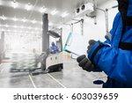 hand of worker holding... | Shutterstock . vector #603039659