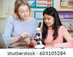 teacher with female student...   Shutterstock . vector #603105284