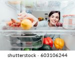 smiling woman taking a fresh... | Shutterstock . vector #603106244