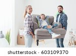 happy young family moving into... | Shutterstock . vector #603109370