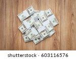 load of cash money on a desktop ... | Shutterstock . vector #603116576